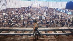 Эрен стоит на стене города